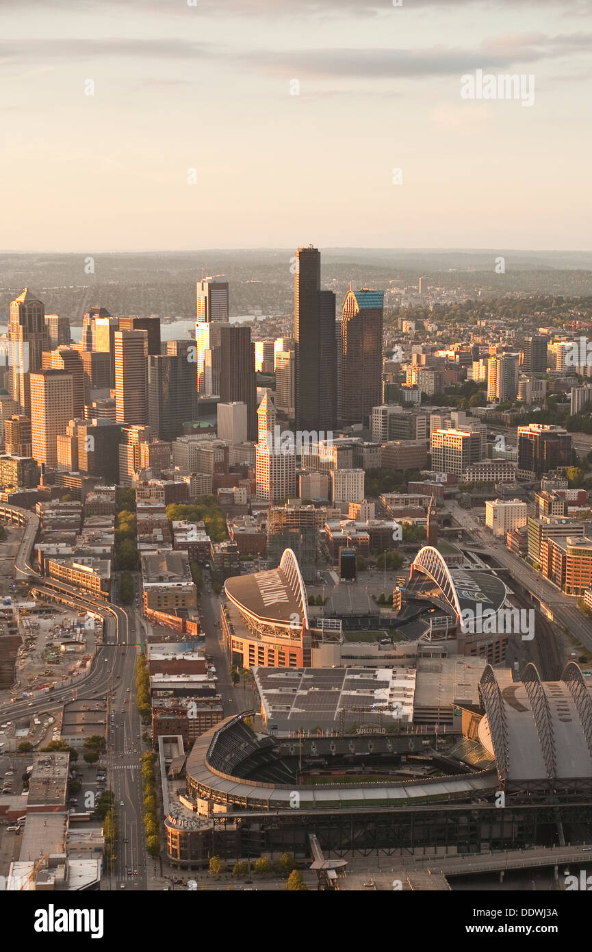 Aerial view of Seattle skyline with stadiums CenturyLink and Safeco fields toward sunset - Stock Image