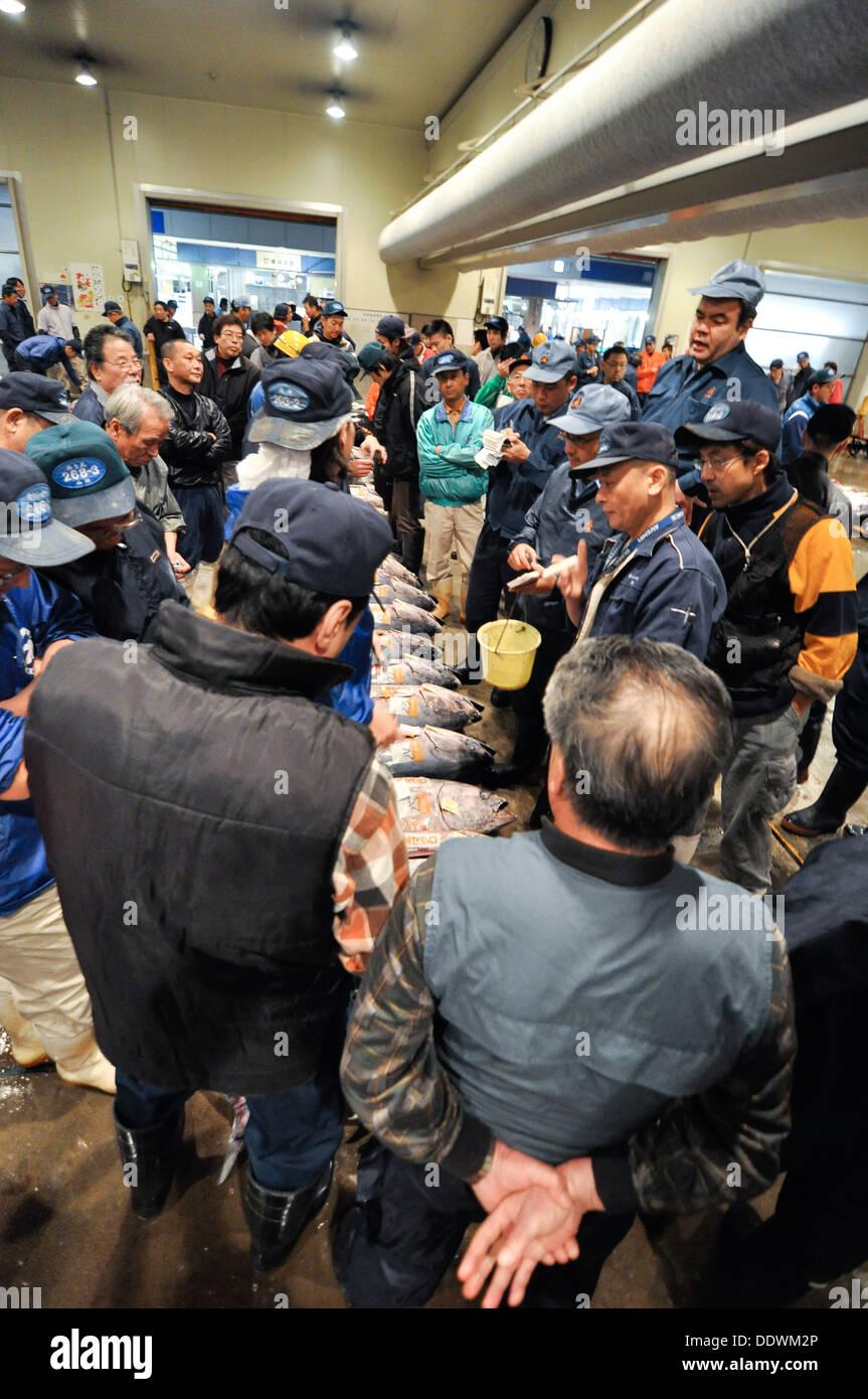 Tuna auction at a fish market in Osaka, Japan. - Stock Image