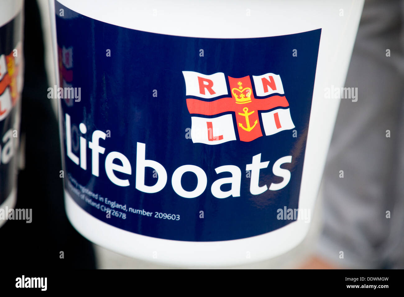 Charities collector / charity collectors collection box / boxes to collect for / collecting for the RNLI / Royal National. UK. - Stock Image