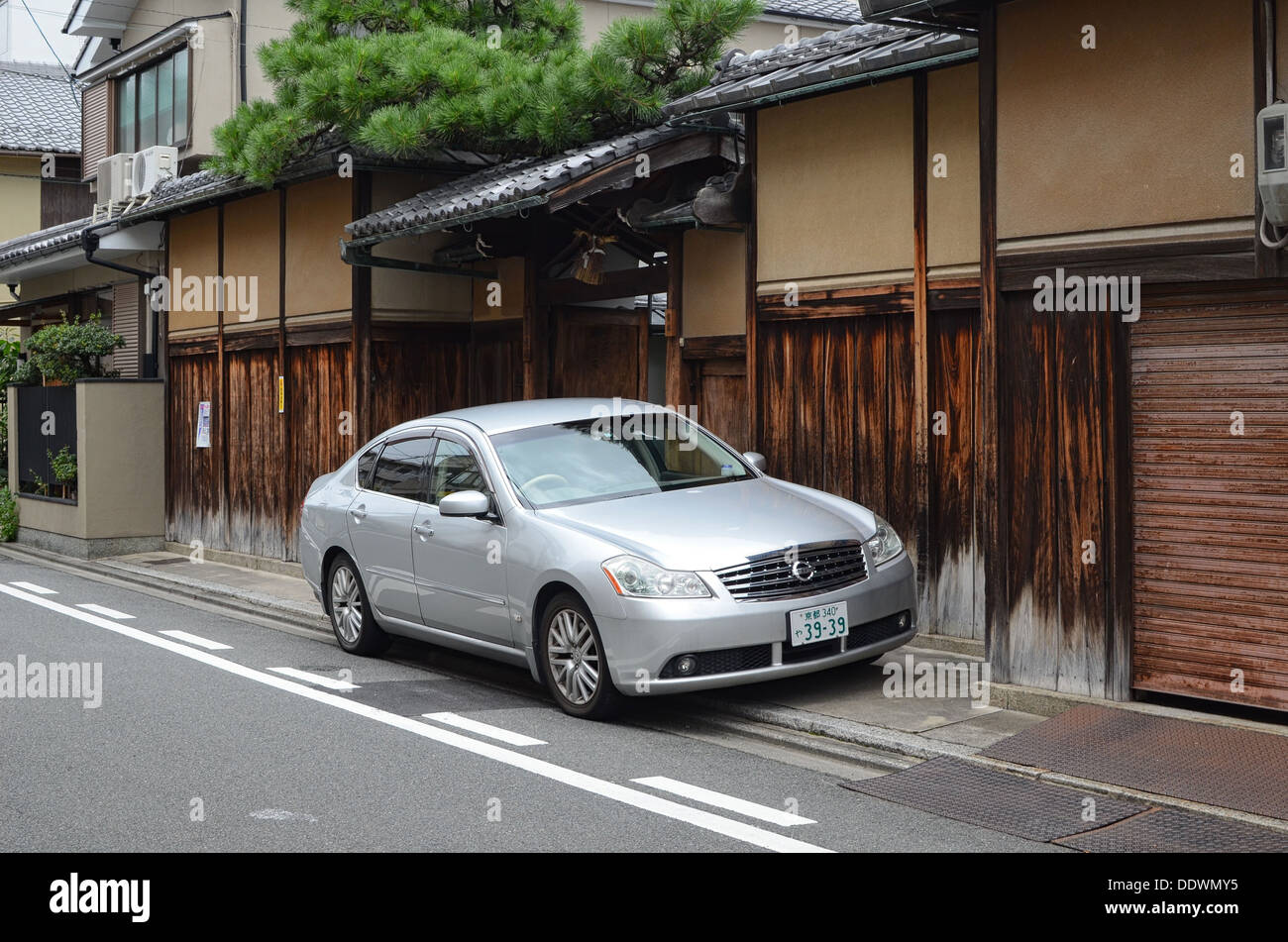 A Nissan car parked in a street in Kyoto, Japan. - Stock Image