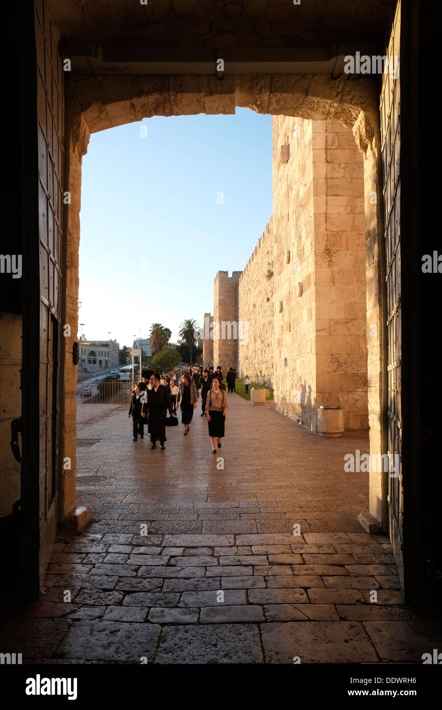 Ultra orthodox Jews entering the stone portal of Jaffa Gate or Bab al-Khalil one of eight gates of the Ottoman walls Stock Photo