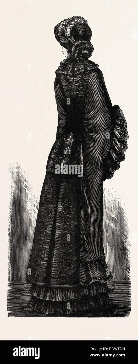 LONG  WINTER MANTLE,  FASHION, ENGRAVING 1882 - Stock Image