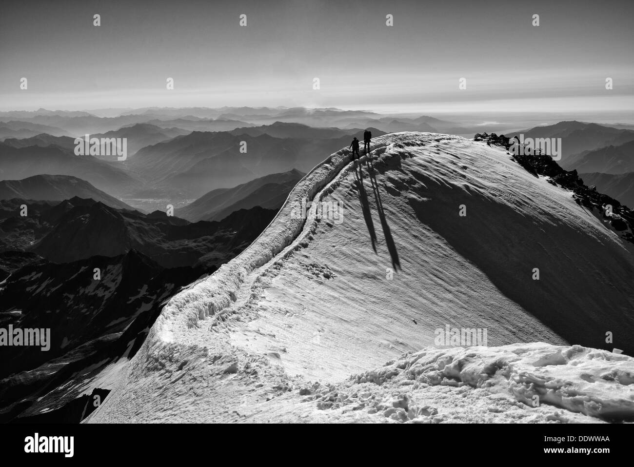 Climbers arriving at the summit of the Weissmies Stock Photo