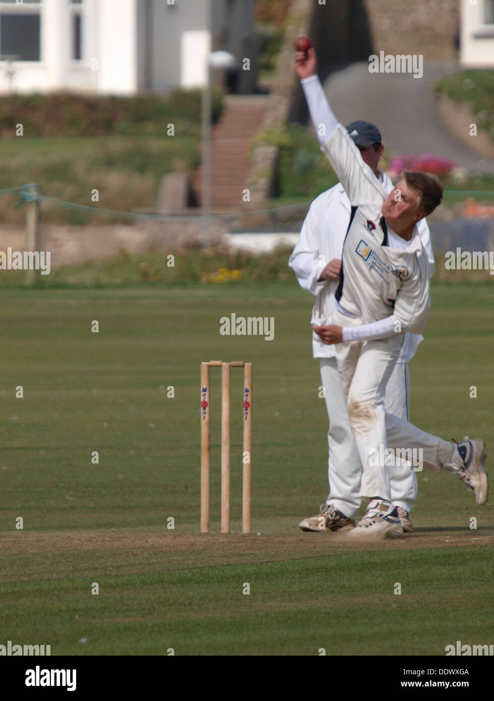 Bowler, Amateur Cricket match, Bude, Cornwall, UK 2013 - Stock Image