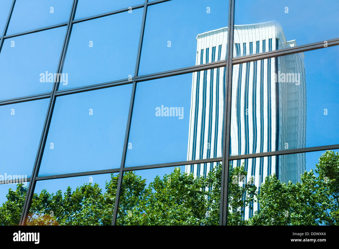 Picasso tower reflected on glass facade. AZCA, Madrid, Spain. - Stock Image