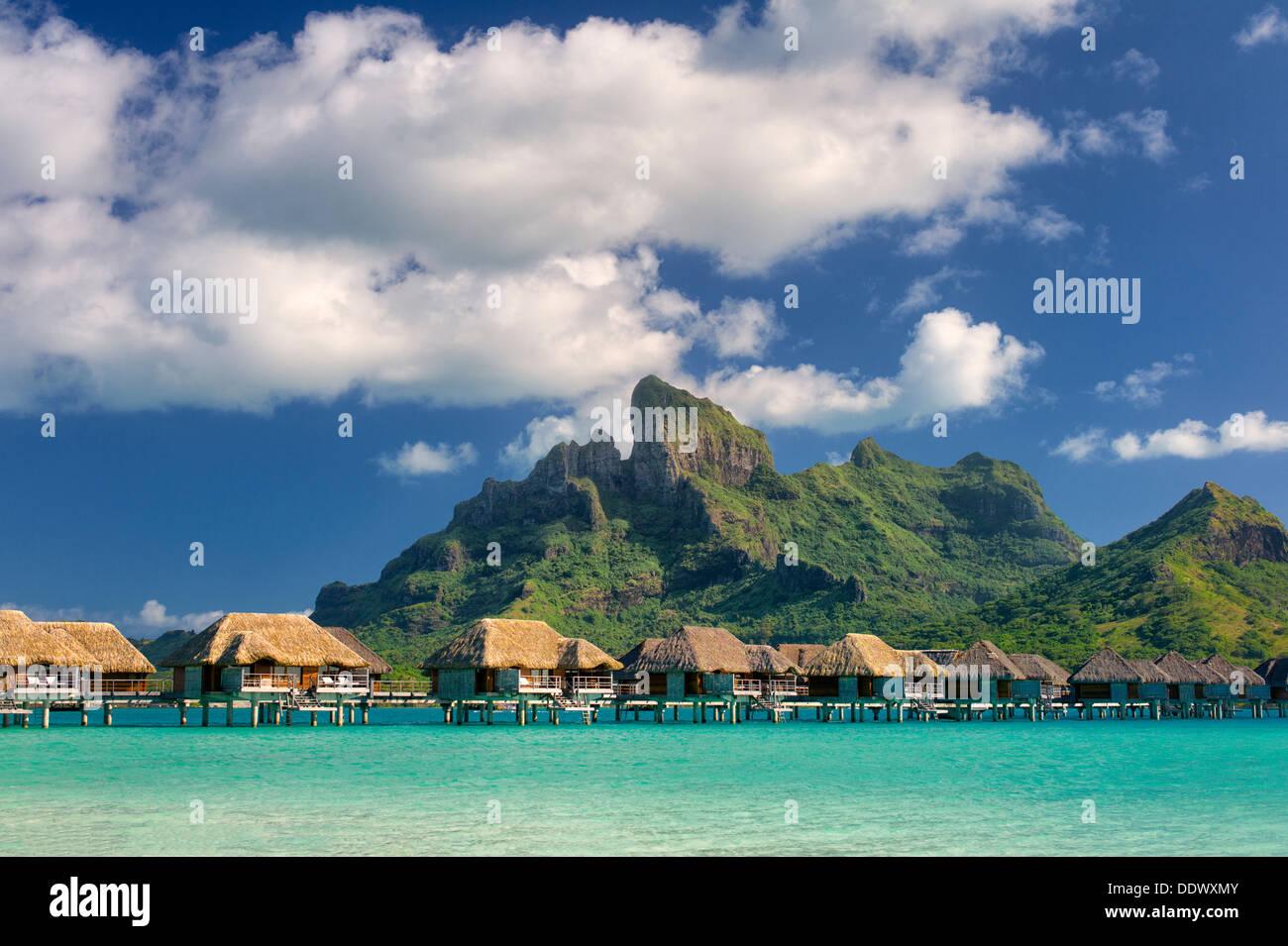 Bungalows over water and Mt. Otemanu. Bora Bora. French Polynesia - Stock Image