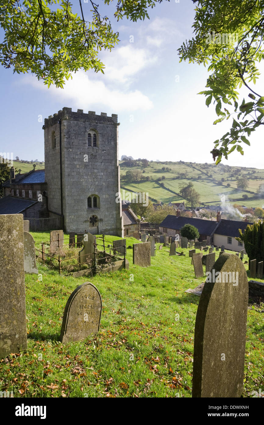 Village churchyard with rolling countryside in the background. Brassington, Derbyshire, UK. - Stock Image