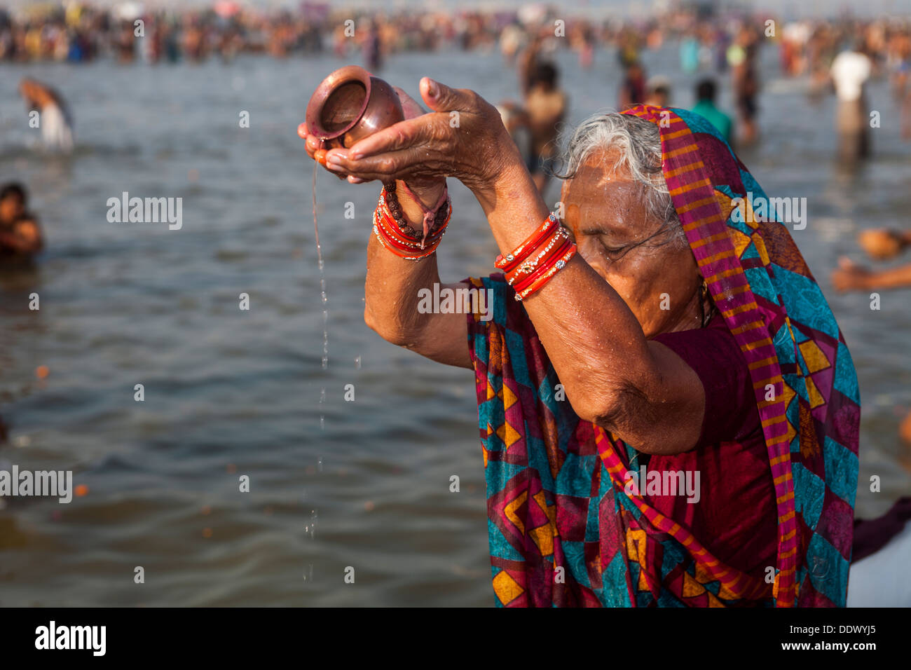 Devotes and Pilgrims taking holy dip in Ganga during the auspicious day at Kumbh Mela 2013, Allahabad, UP India Stock Photo