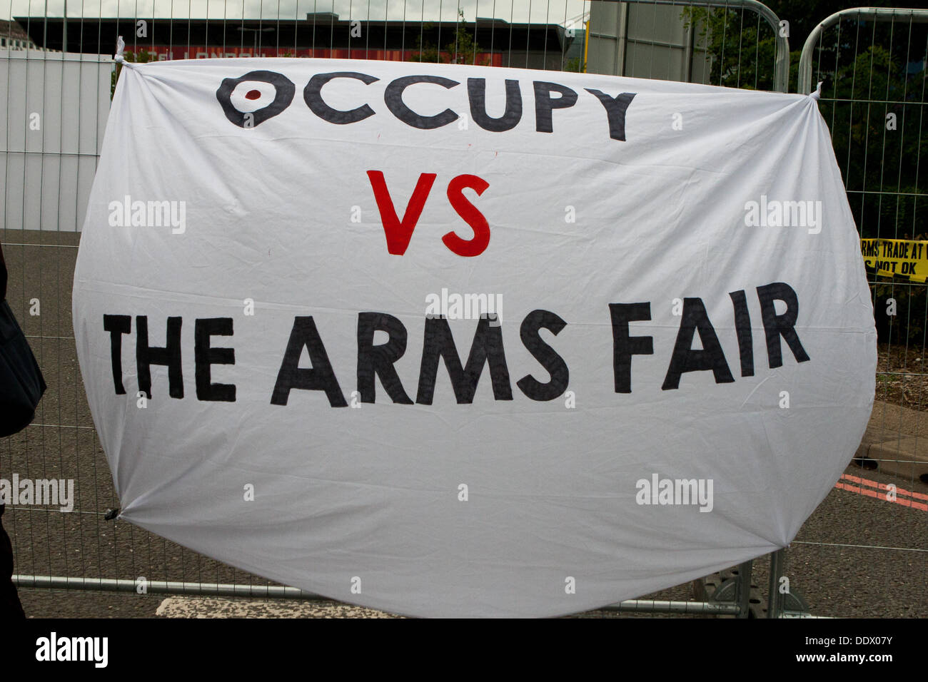 London, UK. 8th Sep, 2013. Occupy Vs The Arms Fair banner at protest against the Defence Security and Equipment Stock Photo