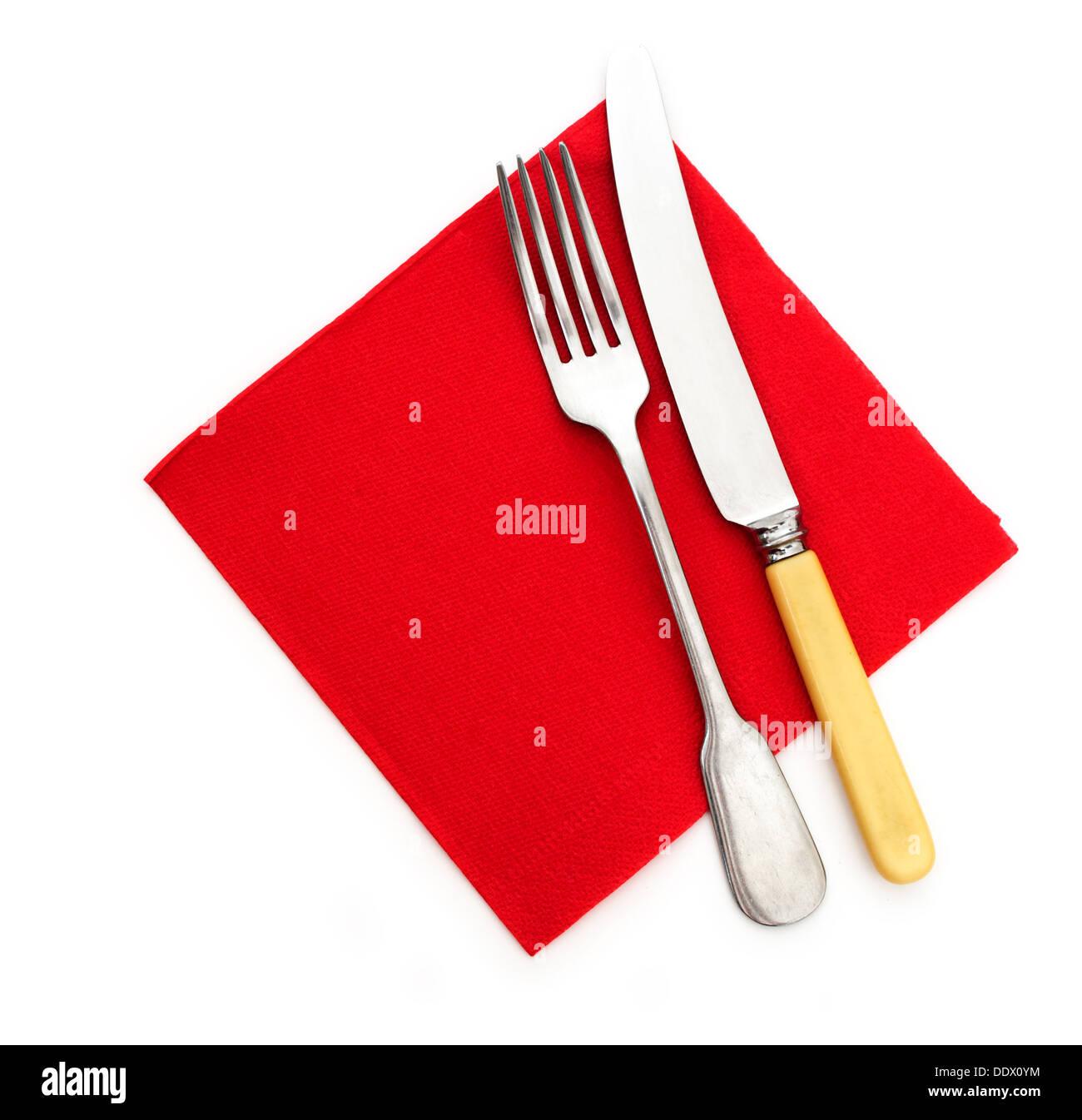 Ready for dinner - knife fork and red paper serviette, napkin - Stock Image