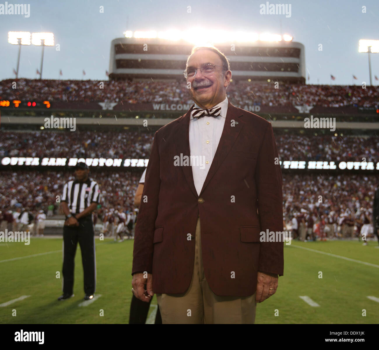 College Station, Texas, USA. 7th Sep, 2013. 9/7/13 - Texas A&M president Dr. R. Bowen Loftin during the coin flip in the game against Sam Houston State at Kyle Field in College Station, Texas Saturday September 7, 2013. A&M won 65-28.Photo by Erich Schlegel Credit:  Erich Schlegel/ZUMAPRESS.com/Alamy Live News - Stock Image