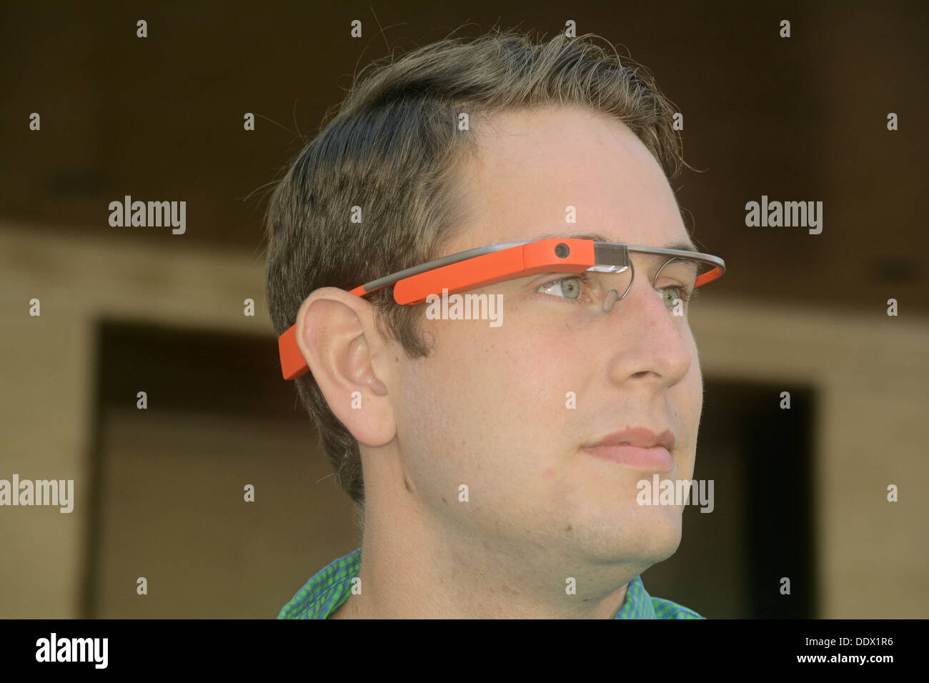 Portrait of a young man named John wearing Google Glasses in Manhattan, New York City at Fashion Week - Stock Image