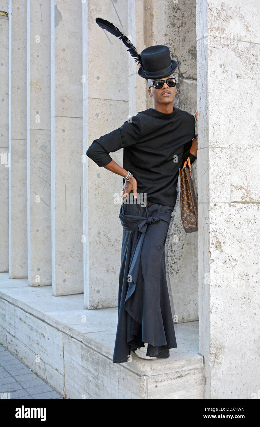 Portrait of a fashion stylist designer wearing an unusual black outfit at Fashion Week at Lincoln Center in New York City - Stock Image
