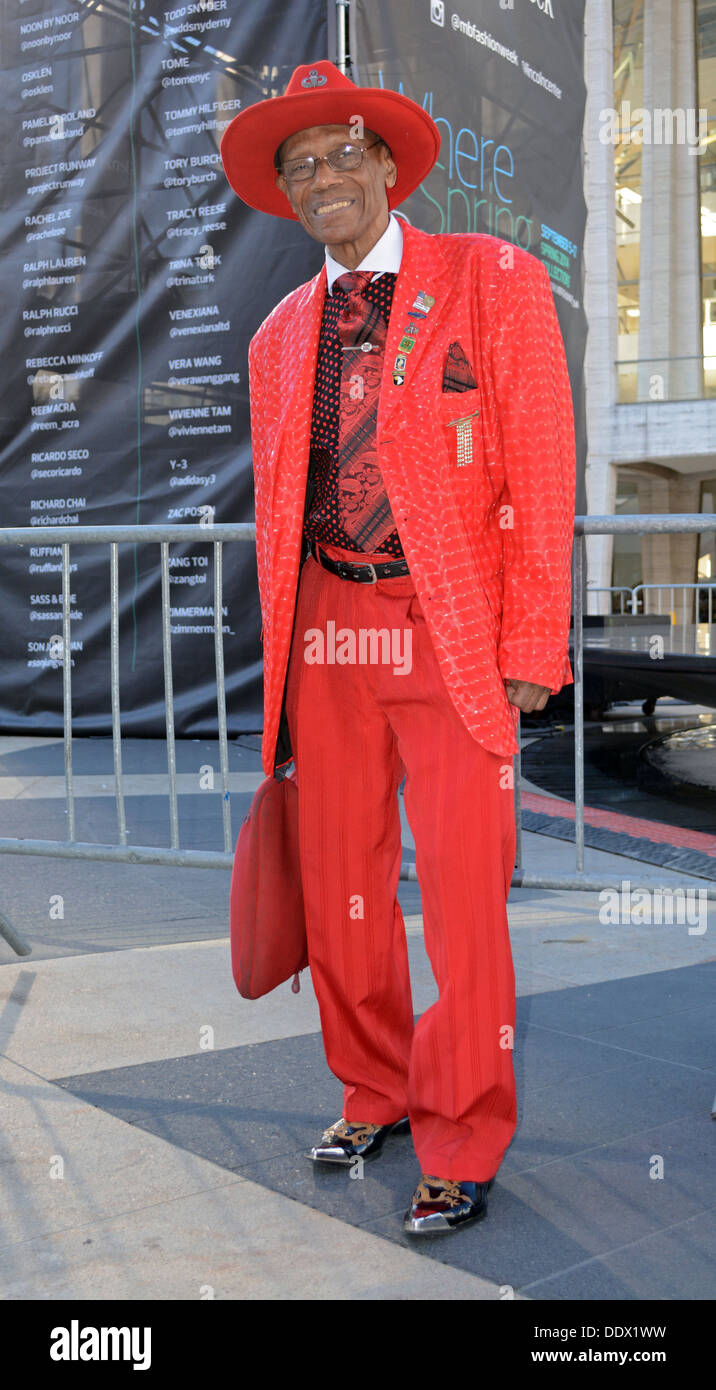 Portrait of a senior Arthur Gonzalves wearing a colorful red outfit at Fashion Week at Lincoln Center in New York City - Stock Image