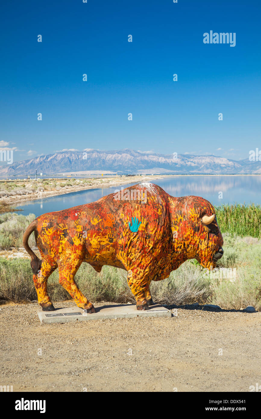 Painted buffalo statue on Antelope Island with the Great Salt Lake in background, Utah - Stock Image