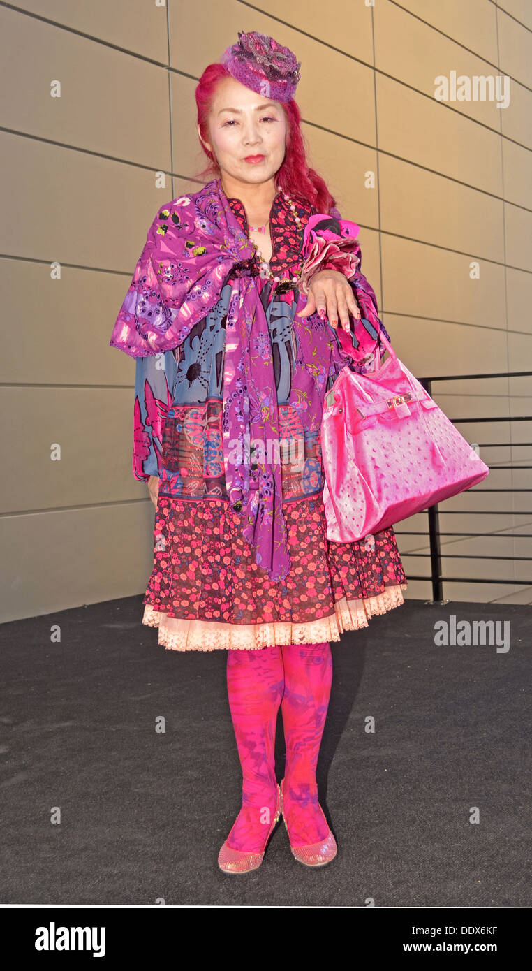 Portrait of a designer for Anna Sui wearing a colorful pink outfit at Fashion Week at Lincoln Center in New York City - Stock Image