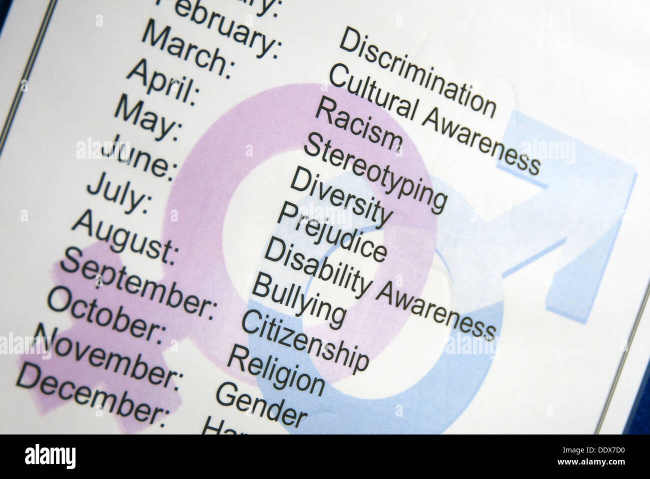 sign with calendar months and social topics from diversity to religion - Stock Image