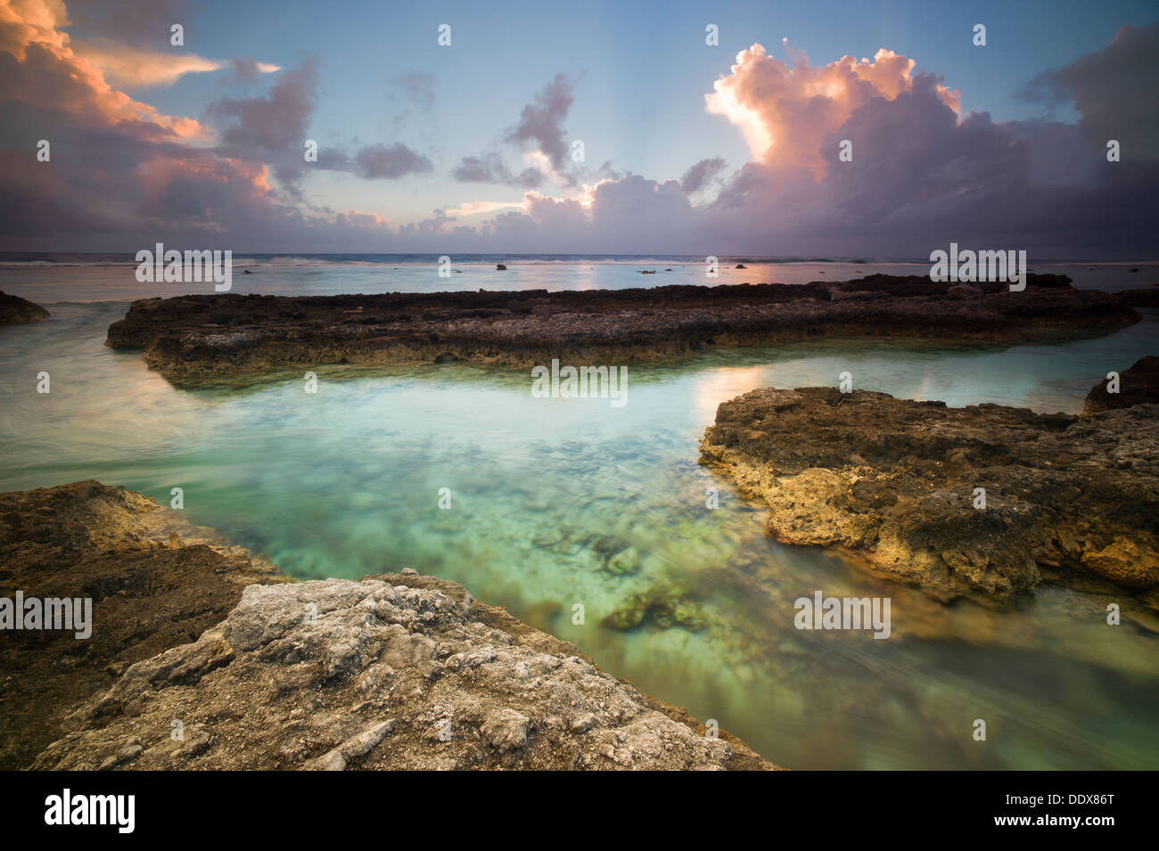 Sunrise shot of the Pacific Ocean side of Bora Bora. French Polynesia - Stock Image