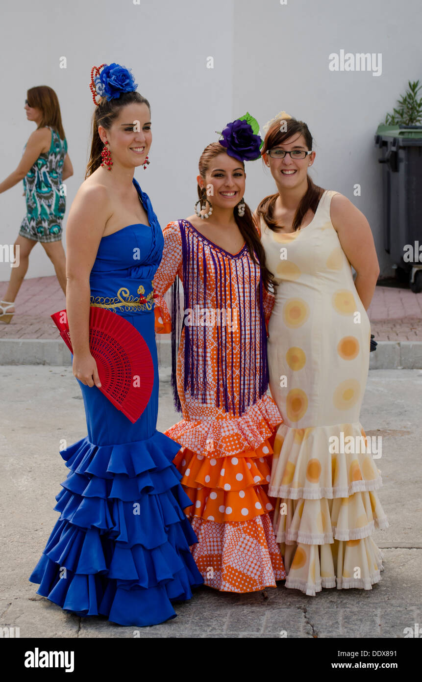 db21fb6368d3 Three girls in a traditional flamenco dresses during the annual feria in  Mijas in Southern Spain. Costa del Sol.