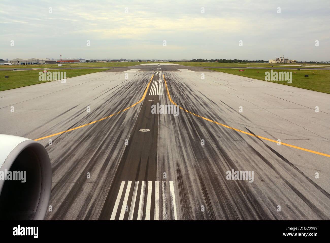 Runway, Airport, Tire Tracks - Stock Image