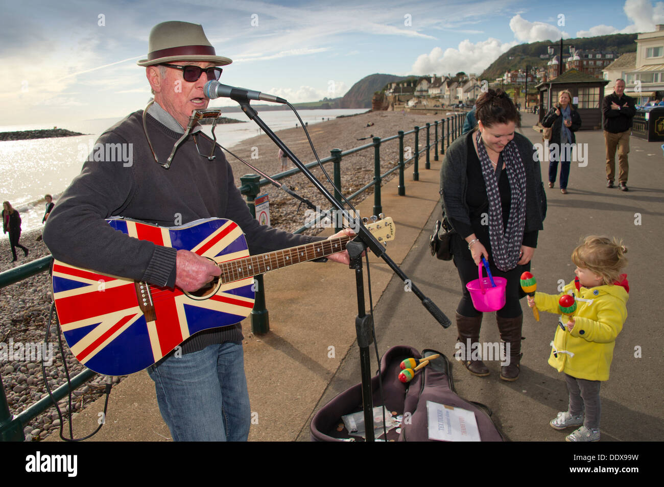 Sidmouth,Devonshire,UK,a seaside town on the South Coast with a promenade and beach,busker and beached boats.a UK Stock Photo