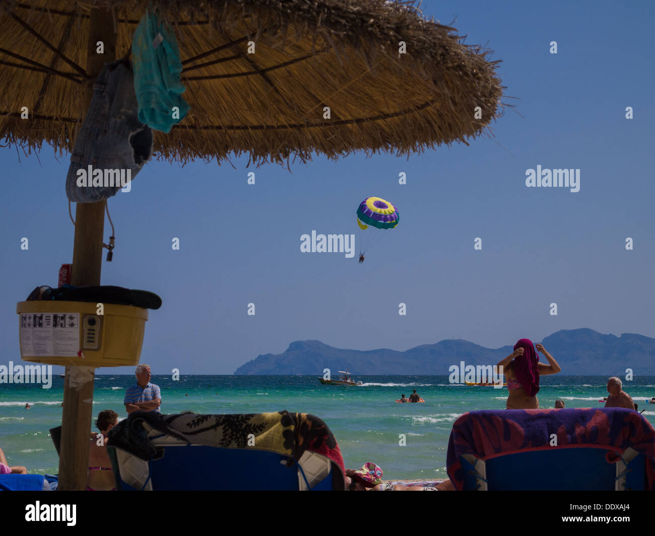 View from a sunbed on Alcudia Beach, Mallorca - Stock Image