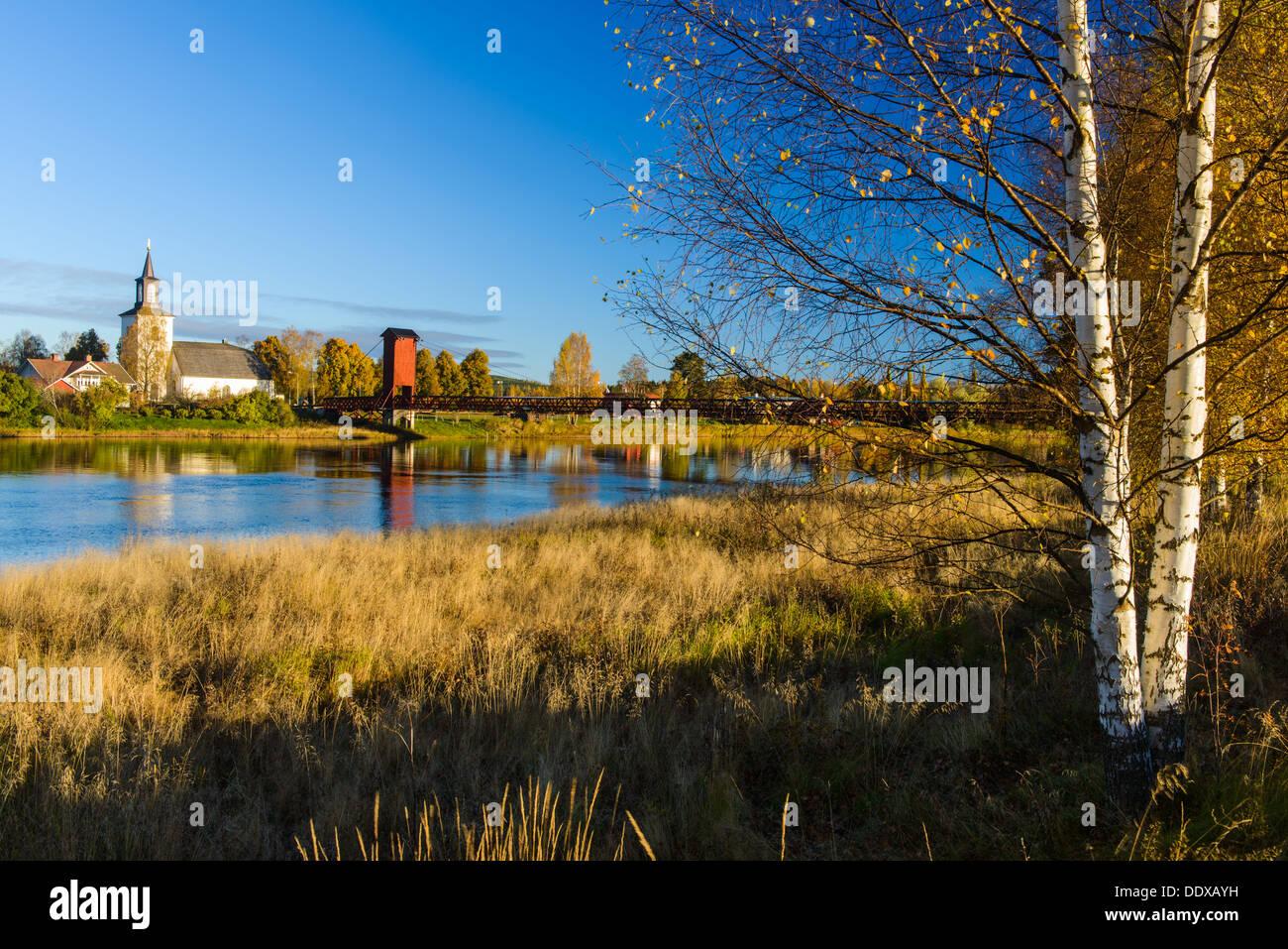 Church and lake, Dala-Floda, Dalarna, Sweden - Stock Image