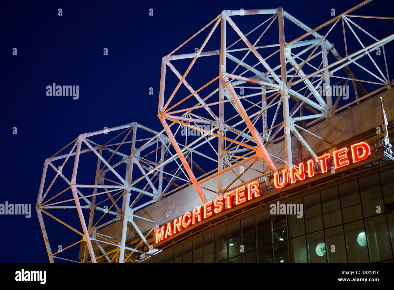 Manchester United's football stadium, Old Trafford, at night - Stock Image