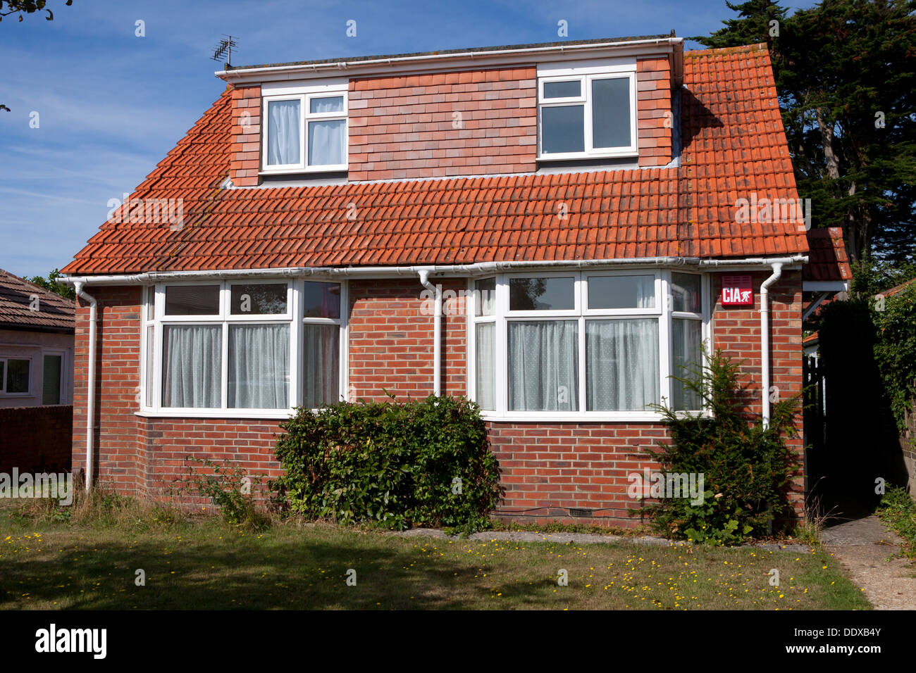 Former bungalow that has been extended to allow upstairs accommodation - Stock Image