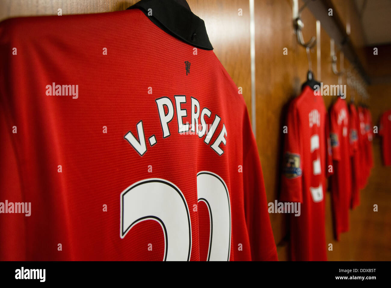 Robin Van Persie's Manchester United football shirt hanging in the old trafford home dressing room - Stock Image