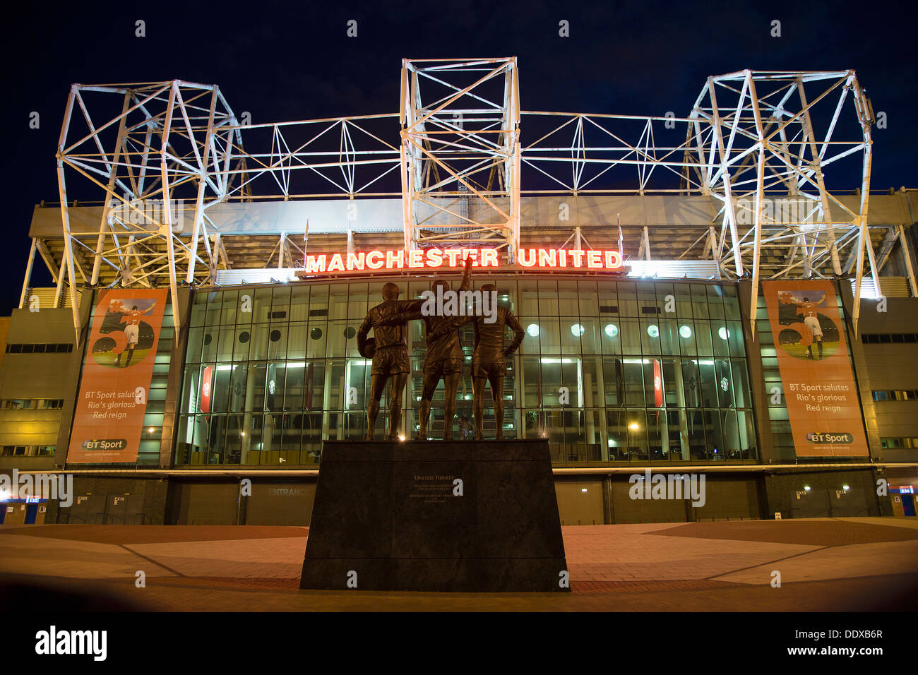 The East Stand of Old Trafford, Manchester United's Football Stadium at night. - Stock Image