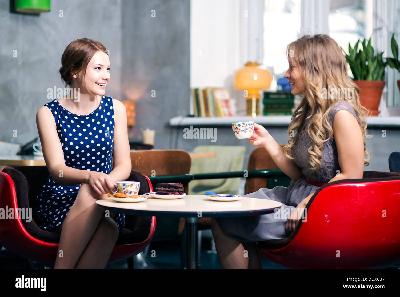 Two womans make dialogue and snile over joke - Stock Image