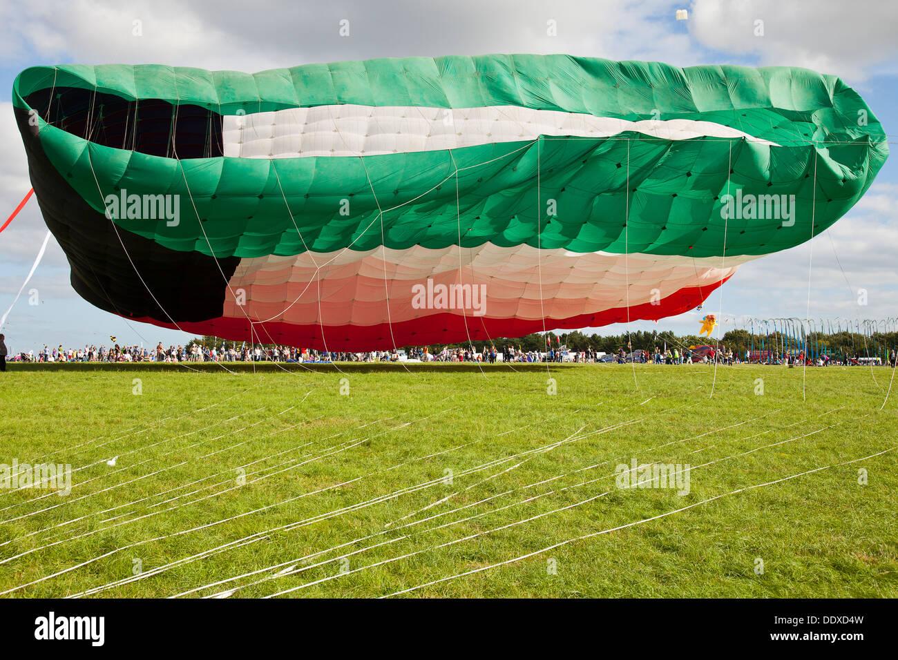 The world's biggest kite, based on the Kuwaiti national flag, flying at the Bristol International Kite Festival 2013 - Stock Image