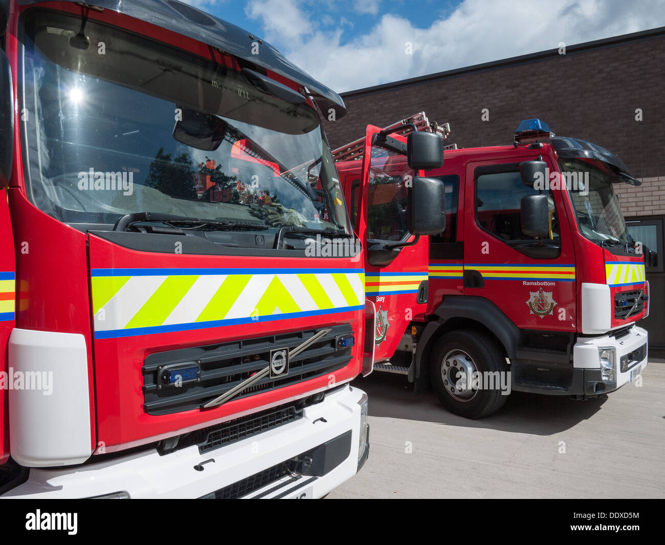 Two fire appliances at a fire station open day in Bury, Lancashire - Stock Image