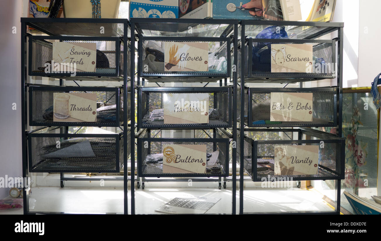 Drawers for haberdashery items in antique shop window display - Stock Image