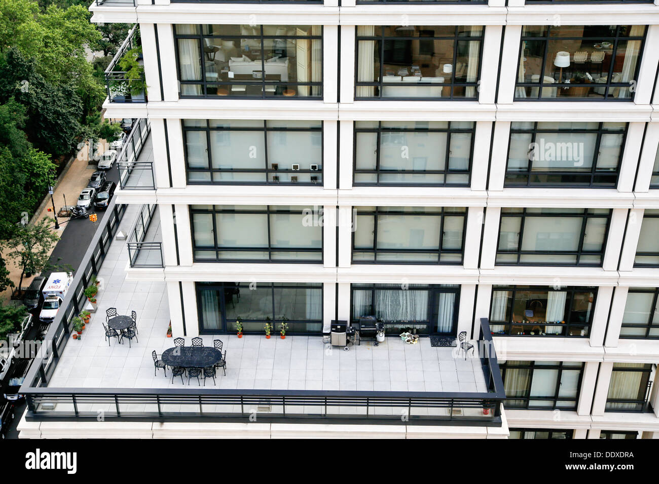 Looking Down at a New York City Condo Apartment Building Set-Back Terrace, New York City in the Background - Stock Image