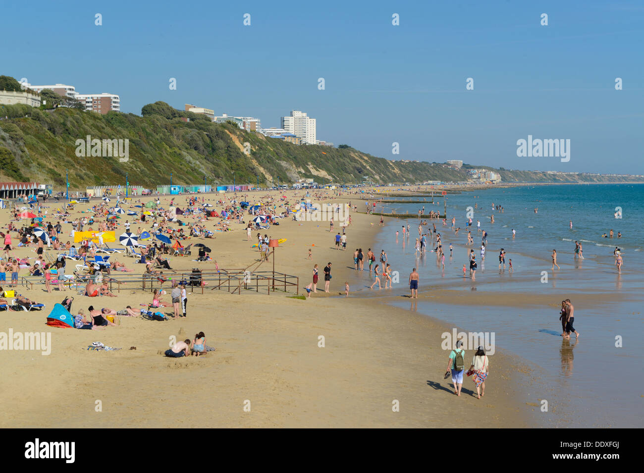 A wide shot of Bournemouth beach taken from the pier during summer in the southern county of Dorset. - Stock Image