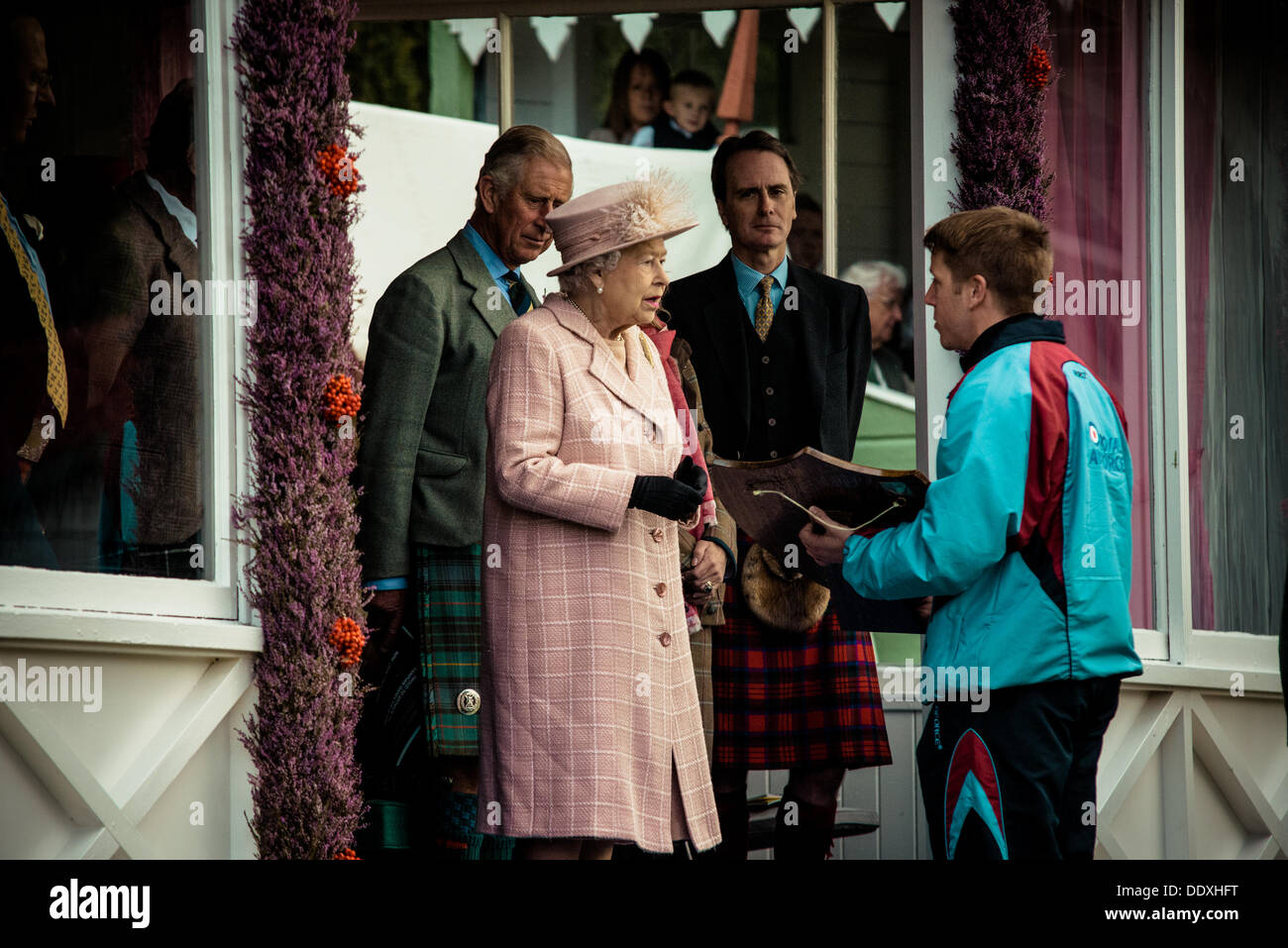 Braemar, Scotland, United Kingdom. September 7th, 2013: H.M. The Queen awards the winner in the relay race  during the annual Braemer Highland Games at The Princess Royal and Duke of Fife Memorial Park - Stock Image