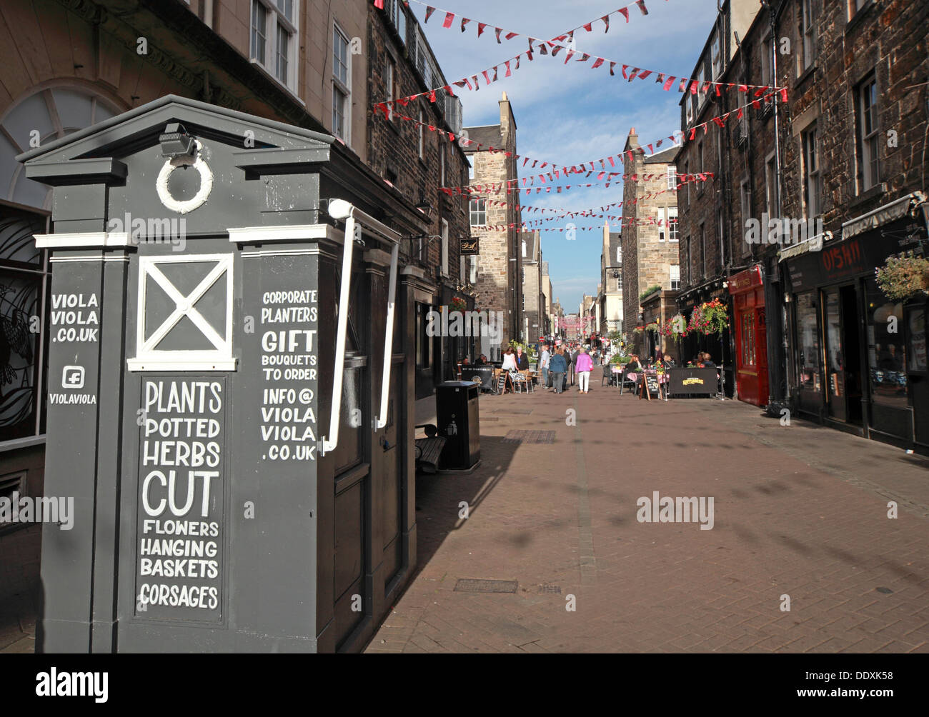 Rose Street,Edinburgh,Scotland,UK a place to drink,eat,party - with old Tardis Police Box - Stock Image