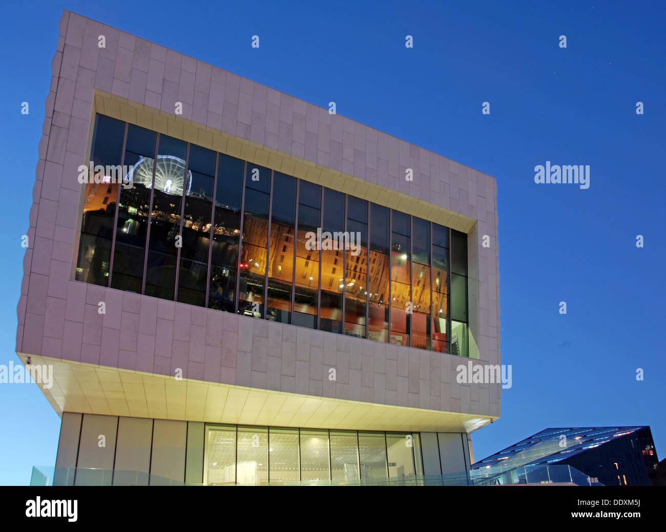 Albert Dock reflected in new museum at Nighttime liverpool Merseyside England UK - Stock Image