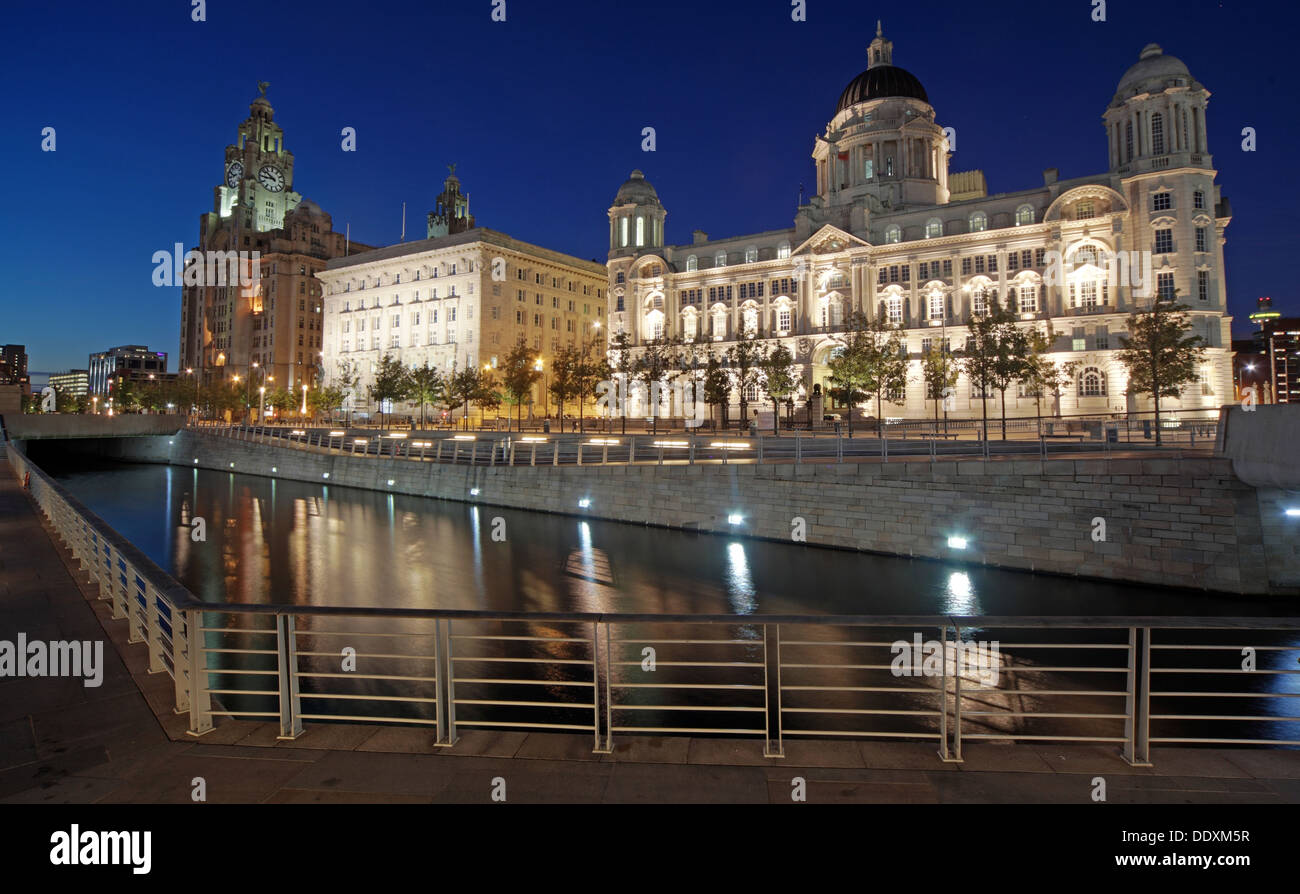 Pier Head Three Graces at Nighttime liverpool Merseyside England UK - Stock Image