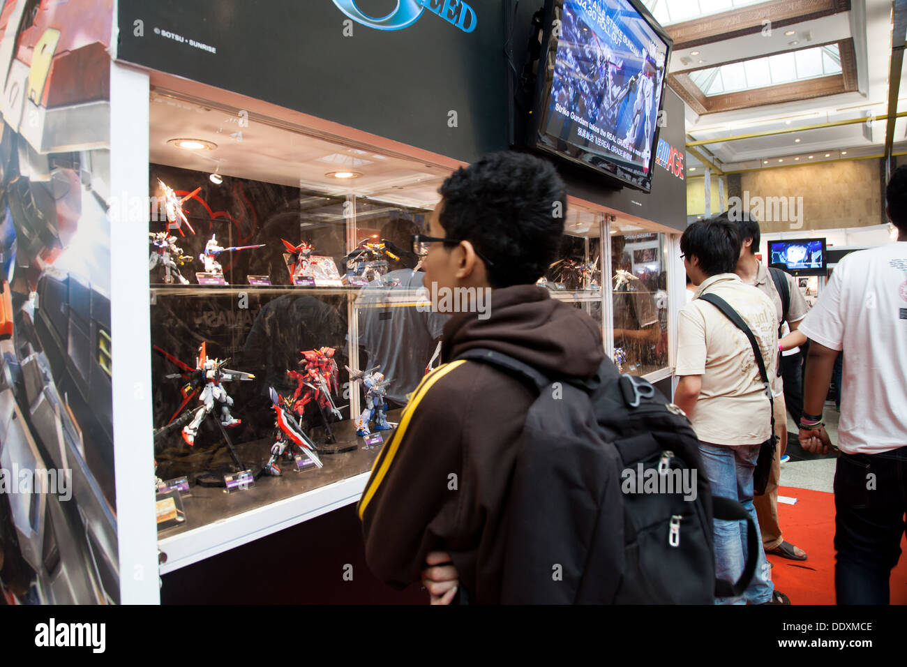 Jakarta Indonesia 8th September 2013 A Visitor Looking At Anime Toy Figurines Inside Glass Showcase In Festival Asia