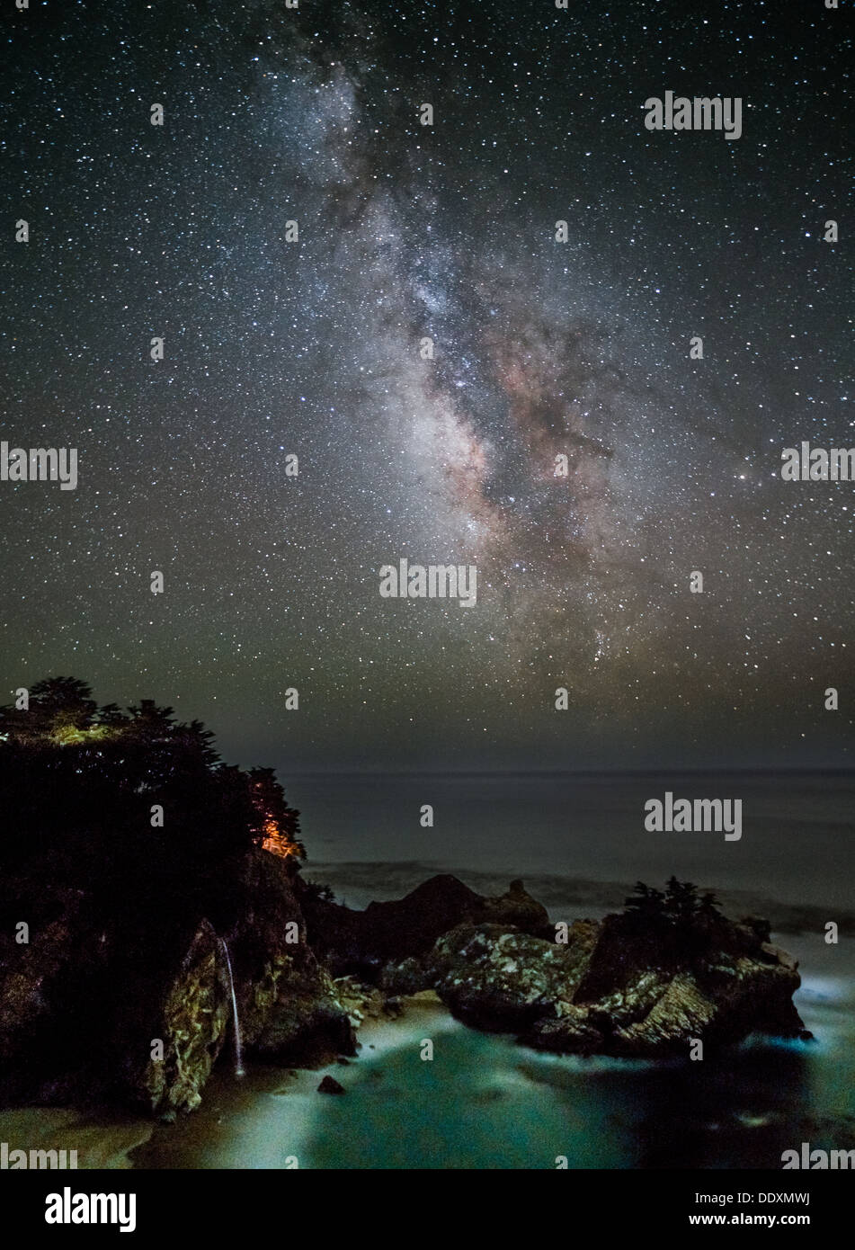 Milky Way Galactic Center Above McWay Falls, Julia Pfeiffer Burns State Park, California - Stock Image