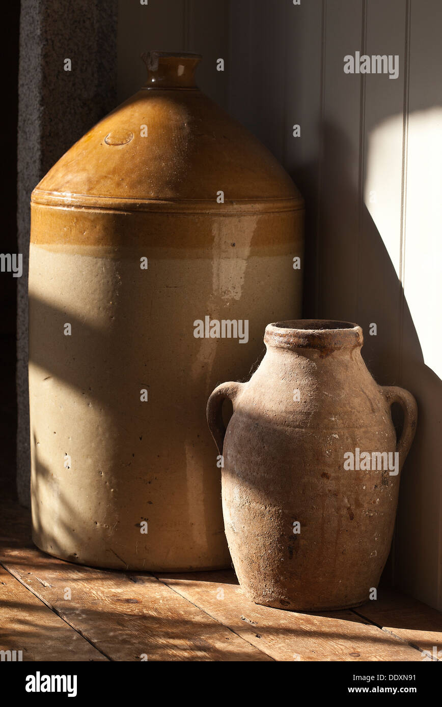 Dusty old vase and antique stoneware pottery from the Doulton factory in Lambeth, London dated 1853 - Stock Image