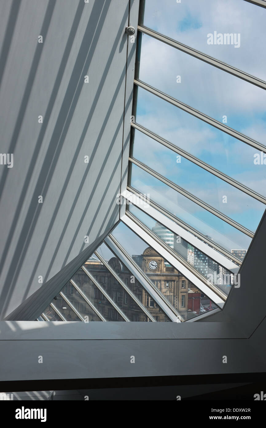 View of Manchester through glass roof of National Football Museum at Urbis in Manchester city centre, UK - Stock Image