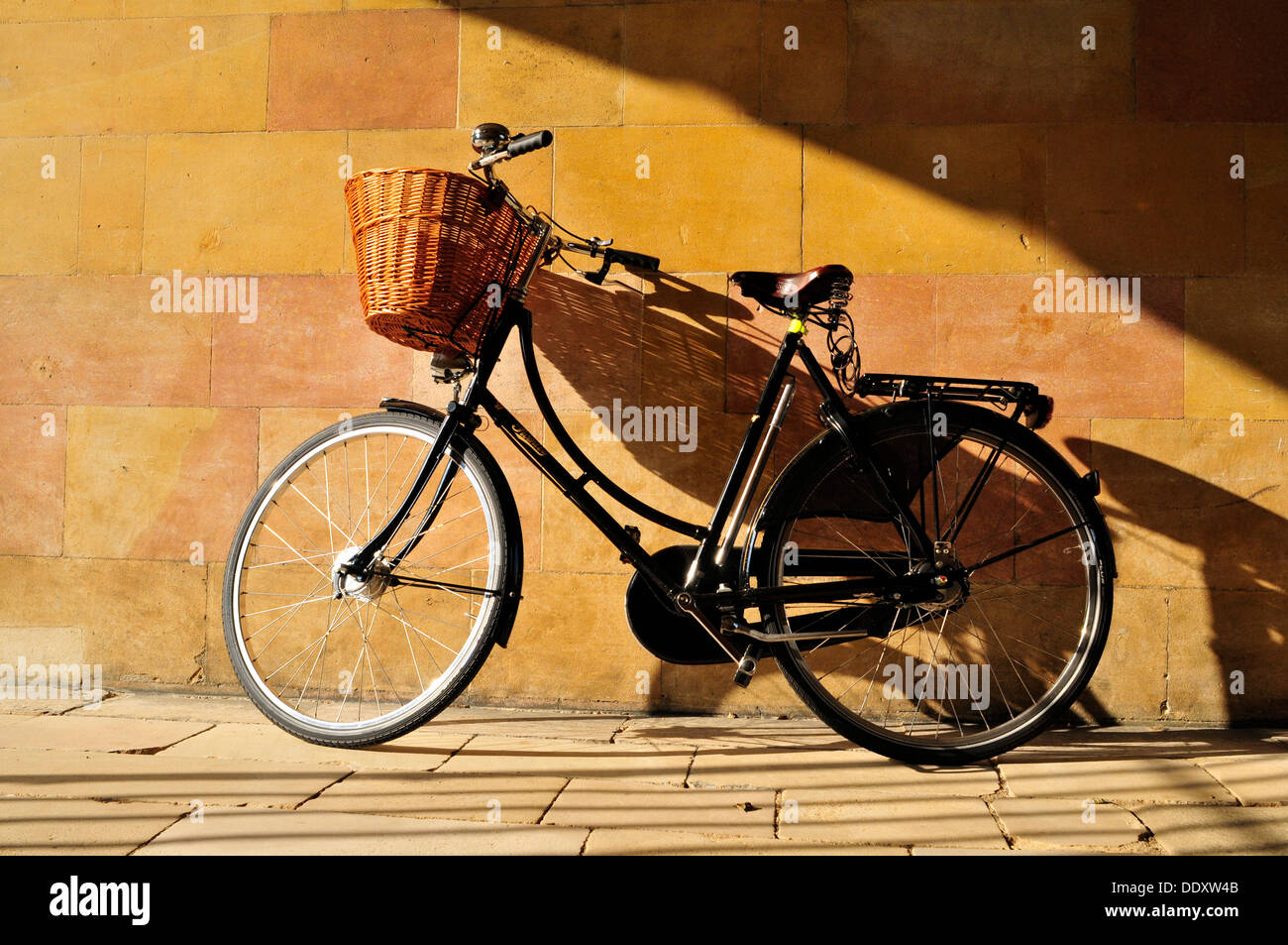 A parked bicycle against a wall, Clare College, Cambridge, UK - Stock Image