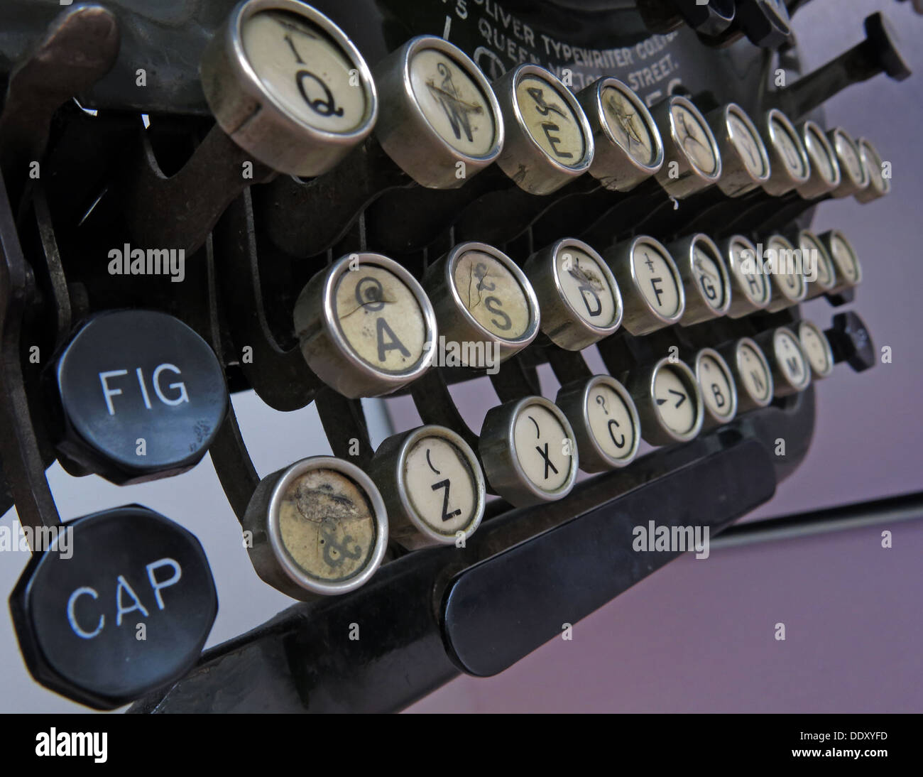 Old classic victorian typewriter machine. Black with ivory keys Stock Photo