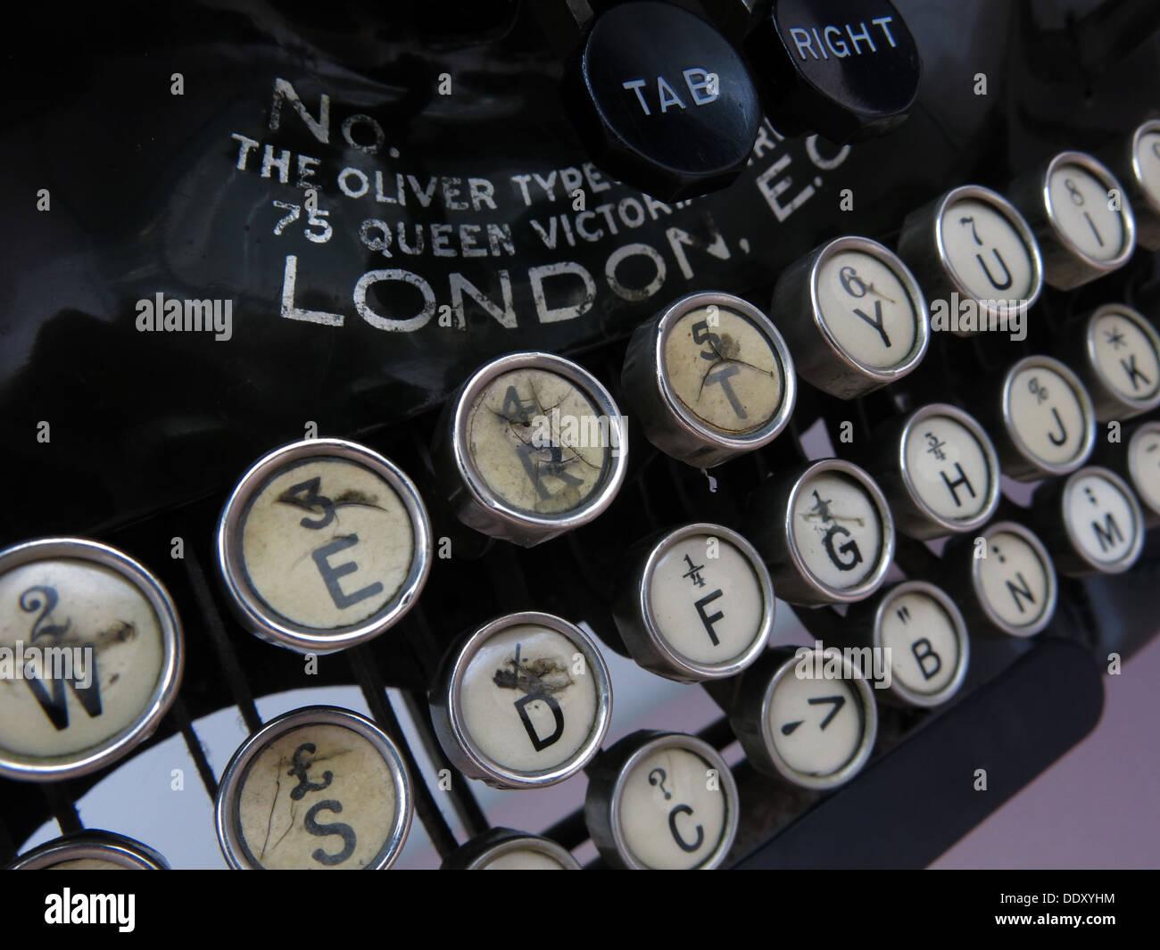 Old classic victorian typewriter machine. Black with ivory keys - Stock Image