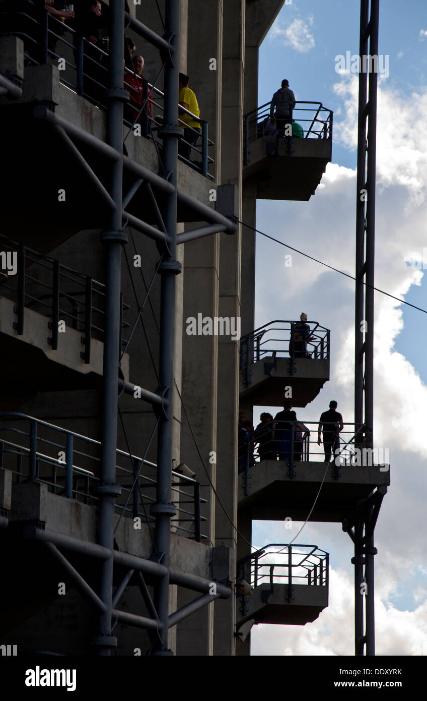People on stairs and landings at Twickenham Rugby Stadium in south west London England UK - Stock Image