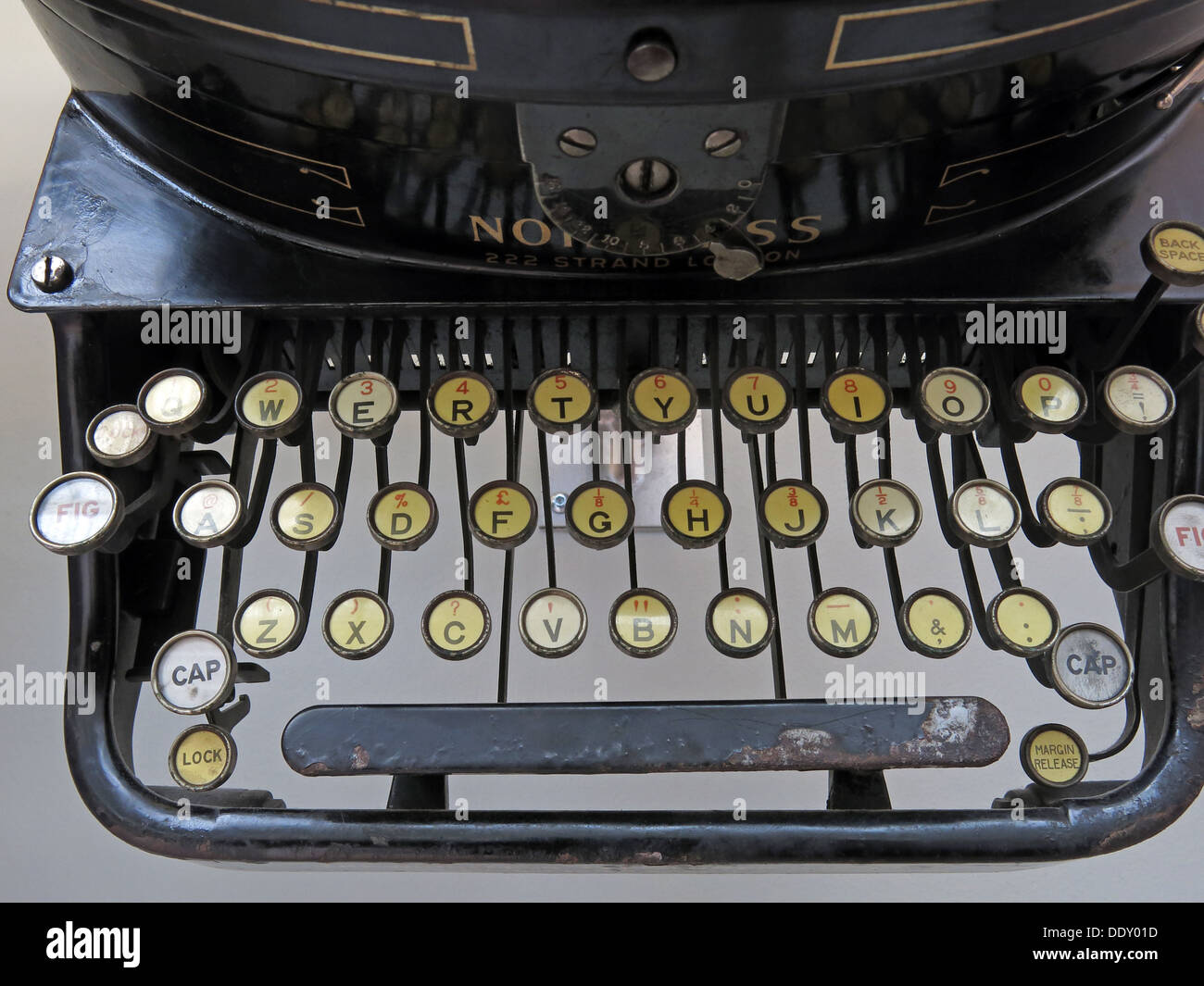 Old classic victorian typewriter machine. Black with ivory keys - Stock Image